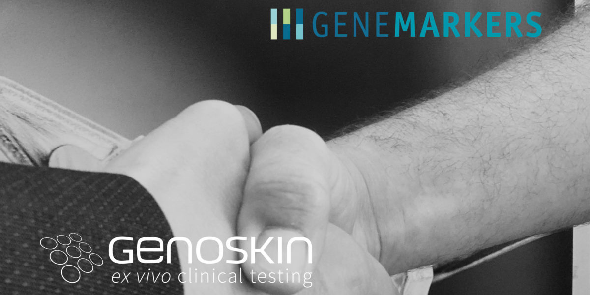 Two people shakings hands illustrating Genemarkers and Genoskin partnership