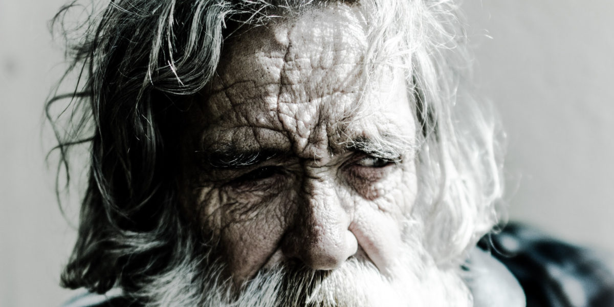 Human and animal skin: Close on an old man's face
